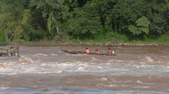 Laos mekong river rapids fishermans Stock Footage