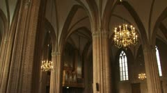 Church interior pan gothic arches and chandeliers Stock Footage