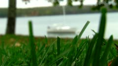 Rack Focus from Grass to Boat on Lake Stock Footage