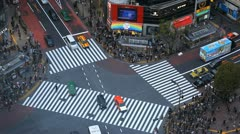 Colorful Car Passing Busy Street Intersection Traffic Jam Tokyo Shibuya Crossing - stock footage