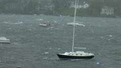 Stock Video Footage of Sailboat in Harbor During Storm