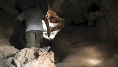 Man Exits Cave Stock Footage