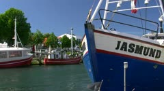 Fishing Boats on Alter Strom in Warnemünde (Rostock) - Baltic Sea, Germany - stock footage