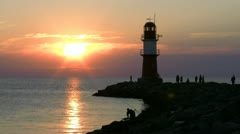 Beautiful Sunset with Lighthouse in Warnemünde - Baltic Sea, Northern Germany Stock Footage