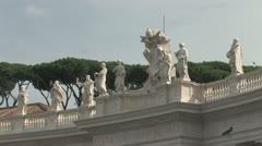 Statues on top of the Colonade of St. Peter's in Rome Stock Footage