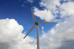 Windmill turbine at blue sky, renewable power, wind energy Stock Photos