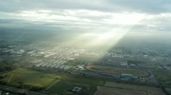 Sunlight Rays Through Clouds Over Urban Area Stock Footage
