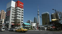Tokyo Sky Tree Office Corporate Tower Building Rush Hour Car Traffic Busy City Stock Footage