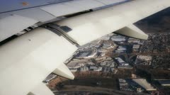 Airplane wing over city Stock Footage