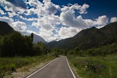 the road to the mountains on the nature - stock photo