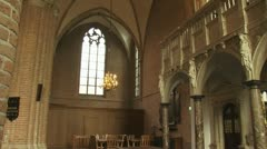Church interior pan gothic arches to rood screen Stock Footage