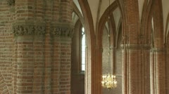Church interior gothic arches, chandelier, organ front - pan Stock Footage