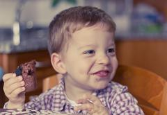 Child eating brownie Stock Photos