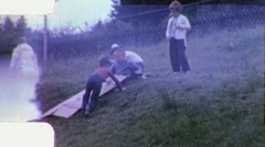 KIDS PLAY CARDBOARD BOX Slide Down PLAYGROUND 1960s Vintage Film Home Movie 5371 Stock Footage