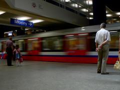 subway arriving at station - stock photo