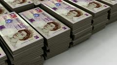 Stacks of £20 banknote (loop) Stock Footage