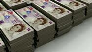 Stock Video Footage of Stacks of £20 banknote (loop)
