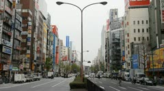 Shinjuku Neon Sign Street, Shopping Area in Tokyo, Japan, Day Traffic Crowds Stock Footage