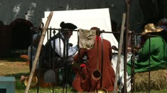 Colonial Men and Women Eating Meal in Camp Stock Footage