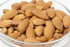 Brown dried almonds Stock Photos