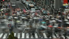 Monsoon Season Rain Rush Hour Tokyo People Walk Shopping Street Crowd Time Lapse - stock footage