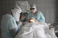 Operation. Surgical table. implantation Stock Photos