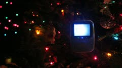 Video baby monitor hanging on christmas tree Stock Footage