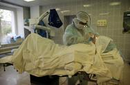 Stock Photo of Operation. Surgical table. implantation