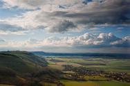 Stock Photo of stunning scene across escarpment countryside landscape with beautiful clouds