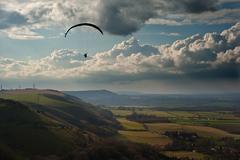 Stunning scene across escarpment countryside landscape with beautiful clouds Stock Photos