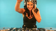 Attractive female DJ mixing music Stock Footage