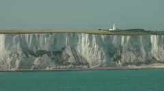 Lighthouse on the white cliffs near Dover, from the sea - stock footage