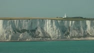 Stock Video Footage of Lighthouse on the white cliffs near Dover, from the sea