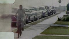 Stock Video Footage of Suburban BOY RIDING BIKE USA Child Kid 1960s (Vinage Film Retro Home Movie) 5384