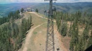 Aspen gondola ride up - rear view extreme tall tower Stock Footage