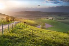 beautiful english countryside landscape over rolling hills - stock photo