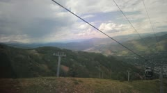 Aspen gondola ride down - front view down into valley Stock Footage
