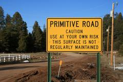 primitive road sign - stock photo