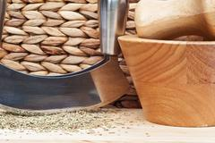 Chopped rosemary with herb chopper in kitchen scene Stock Photos