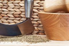chopped oregano marjoram leaves with herb chopper in kitchen setting - stock photo