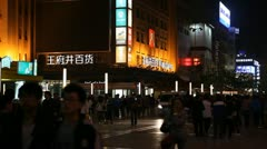 Silver Street in Beijing, China, Famous Shopping Neon Lights by night, Shoppers Stock Footage