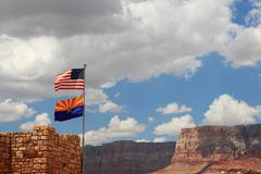 Us and arizona flags fly near marble canyon Stock Photos
