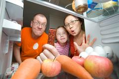 Hungry family Stock Photos