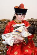 Mongolian nainen ja vauva Kuvituskuvat