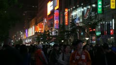 Neon Lights by night, Famous Shopping Silver Street in Beijing, China, Shoppers Stock Footage