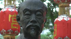 Beautiful red lantern hanging near to bronze statue, China Stock Footage