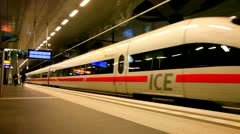 Modern high-speed train costs at a platform of the Central station in Berlin - stock footage
