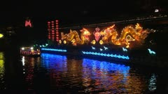 Boats on Xuanwu river with golden dragon by night, Nanjing, China Stock Footage
