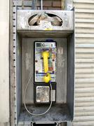 dirty broken public phone - stock photo