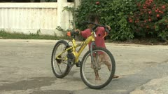 Asian Boy Pushes A Bike During Songkhran Water Festival Stock Footage